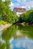 Summer cityscape – river surface with blue sky and green trees reflection. Summer cityscape – river surface with blue sky and green trees reflection Stock Photography