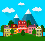 Summer cityscape with mountains. Royalty Free Stock Photography