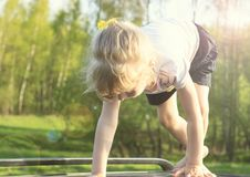 Summer. A clear, sunny day. girl with white hair getting ready to run.  Royalty Free Stock Image
