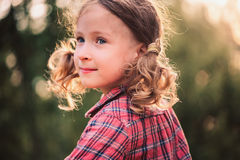 Summer close up outdoor portrait of curly smiling child girl Stock Image