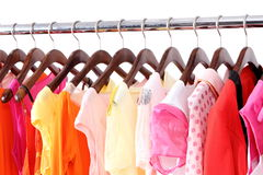 Summer clothes. Multi-coloured women's summer clothes hangs on a hanger on white background royalty free stock photo