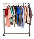 Summer clothes. The multi-coloured men's clothes hangs on a hanger on white background stock photo