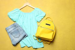 Summer clothes, stylish yellow backpack royalty free stock photos