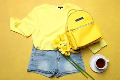 Summer clothes, stylish yellow backpack stock image
