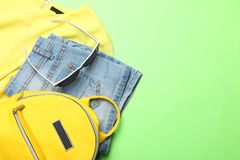 Summer clothes, stylish yellow backpack and sunglasses stock photo