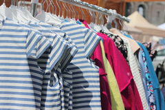 Summer clothing on a hanger in a row Royalty Free Stock Photos