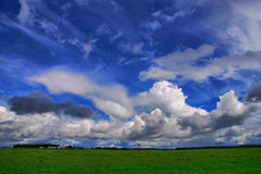 Summer Clouds. Form over a farm just before a storm Stock Image