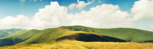 Summer clouds above Carpathian mountain meadows Royalty Free Stock Photos
