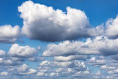 Summer clouds against a blue sky stock image