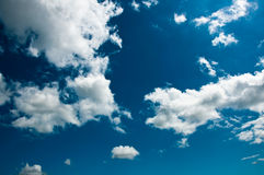 Summer Clouds on Blue Sky. Fair weather cumulus clouds against a bright blue sky Royalty Free Stock Photo
