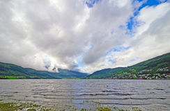 Summer Clouds over a Mountain Lake Stock Photo
