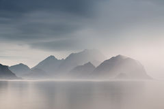 Summer cloudy Lofoten islands. Norway misty fjords. Summer cloudy Lofoten islands. Norway misty sea and fjords. Nordic rain Stock Image