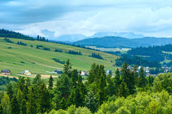 Summer cloudy mountain village view (Poland) Stock Images