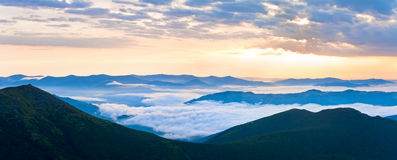 Summer cloudy sunrise mountain panorama Stock Photos