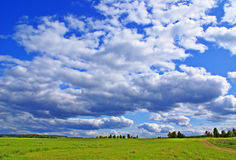 Summer cloudy view. Summer rural view landscape background Royalty Free Stock Image
