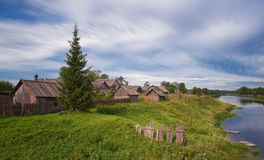 Summer cloudy  weather.landscape with river valley and typical village house in the countryside.The old farmhouse . Royalty Free Stock Images