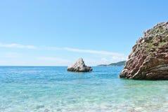 Summer coastal landscape - rocky beach and turquoise sea Stock Photos