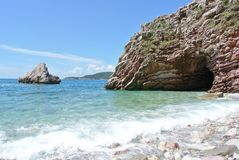 Summer coastal landscape - rocky beach and turquoise sea Royalty Free Stock Image