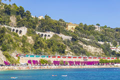 Summer coastline in Villefranche-sur-Mer, City of Nice, France. Panoramic view of summer coastline and crowded mediterranean summer beach in Villefranche-sur-Mer Royalty Free Stock Photos