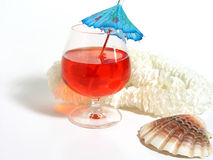 Summer Cocktail. Fruity drink with umbrella, lei and seashell stock photo