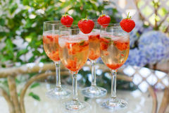 Summer cocktail with champagne, peppermint and fresh strawberrie Stock Images