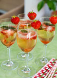 Summer cocktail with champagne, peppermint and fresh strawberrie Stock Photography