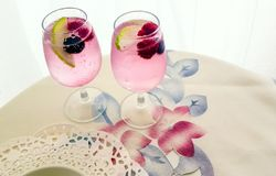 Summer cocktail on a floral map stock photos