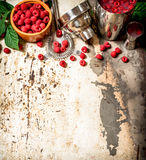 Summer cocktail of fresh raspberries. On rustic background Stock Image
