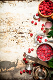 Summer cocktail of fresh raspberries. On rustic background Stock Photos