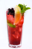 Summer cocktail of fruit and citrus. Refreshing summer cocktail of berries and fruits with a slice of citrus mint with ice crumbs on a white background Stock Photography