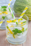 Summer cocktail from melon, mint and soda drink Royalty Free Stock Image