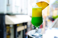 Summer cocktail on the terrace. Yellow green cocktail on the terrace Royalty Free Stock Image