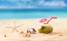Summer coconut cocktail on the beach. Summer coconut cocktail on tropical beach Stock Photo