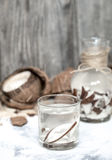 Summer coconut drink. On a wooden background, the concept of refreshing drinks Stock Photography