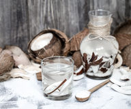 Summer coconut drink. On a wooden background, the concept of refreshing drinks Royalty Free Stock Photo