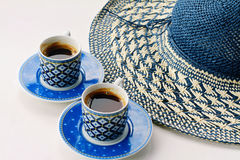 Summer coffee break , female straw hat and two cups of turkish coffee Royalty Free Stock Photo