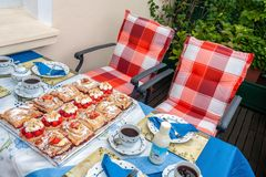 Summer Coffee time. Summerly set coffee-table with tartes-selection on a balcony Royalty Free Stock Photos