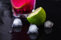 Summer cold cocktail with garnet seeds stock images