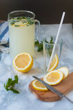 Summer cold drink with lemon and mint. Refreshing lemonade with lemon and mint stock photo