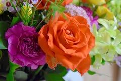 Flowers bouquet roses orange. Summer color flowers arrangement royalty free stock images