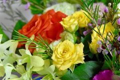 Flowers bouquet roses orange and yellow roses. Summer color flowers arrangement royalty free stock photos