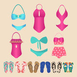 Summer colorful set of flip-flops and swimsuits isolated Stock Photography