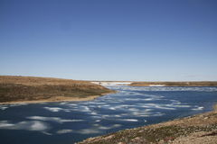 Summer colours in the high arctic with ice in the bay near Cambridge Bay Royalty Free Stock Photo