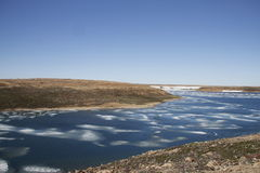 Summer colours in the high arctic with ice in the bay near Cambridge Bay Stock Photo