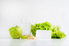 Summer is comming soon. Green apple still water. Green apple, tape-line, still water and lettuce Royalty Free Stock Image
