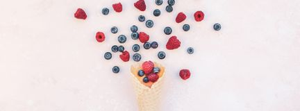 Summer composition berries ice cream waffle cone. Creative Summer concept composition flat lay top view sweet fresh red raspberries blueberries ice cream waffle stock images