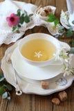 Summer composition: Romantic tea drinking with jasmine green tea. Vintage style, focus selective Stock Image