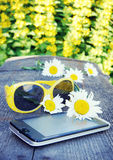 Summer composition with smartphone and sunglasses Royalty Free Stock Photos