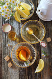 Summer composition: tea with lemon and honey. Summer composition: glass of tea with lemon and honey Royalty Free Stock Photo