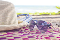 Summer concept with accessories on sand Stock Images